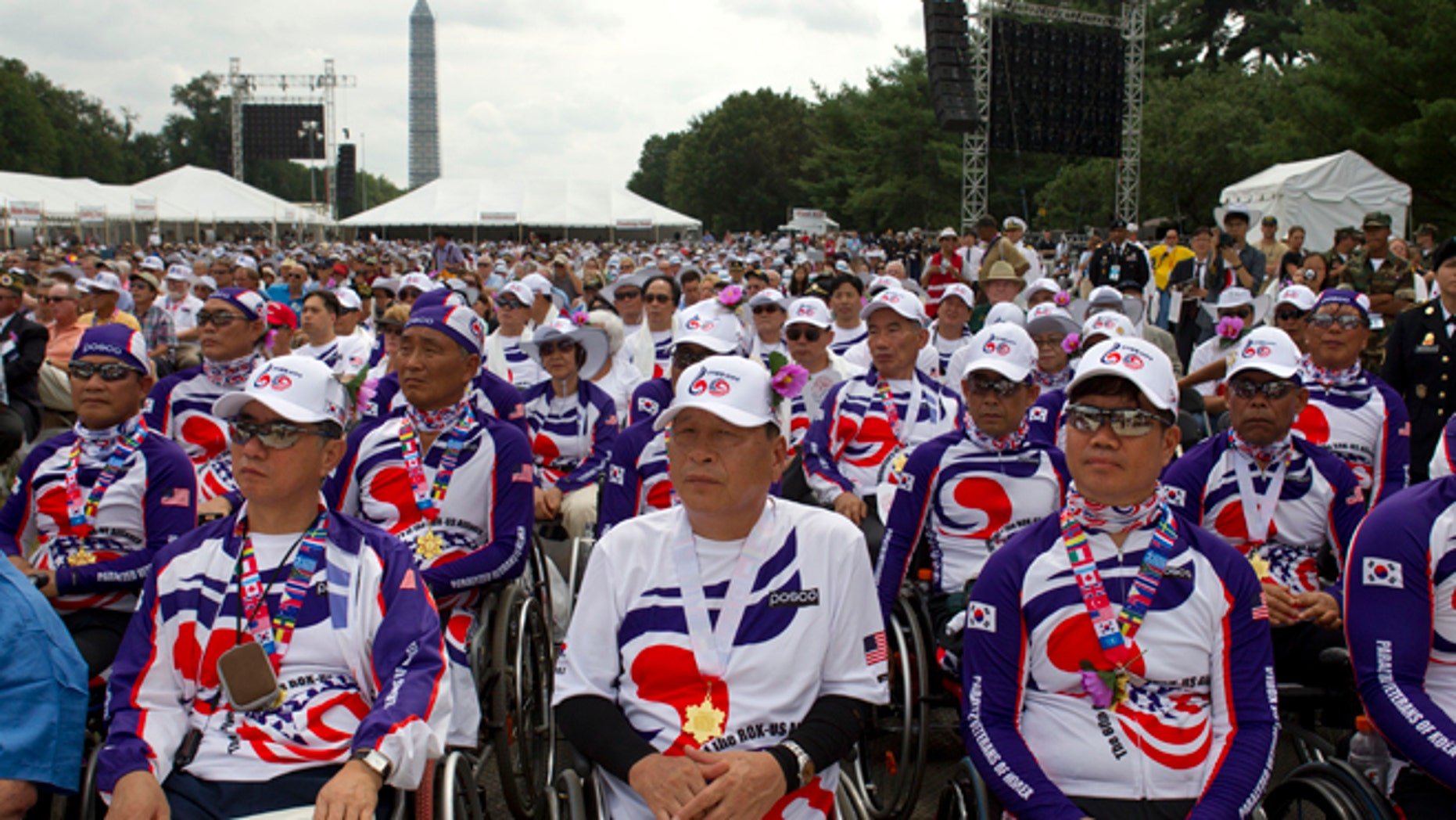 Saturday, July 27, 2013: Paralyzed Veterans of Korea watch as President Obama speaks at a ceremony marking the 60th anniversary of the end of the Korean War, near the Korean War Veterans Memorial  in Washington, D.C.