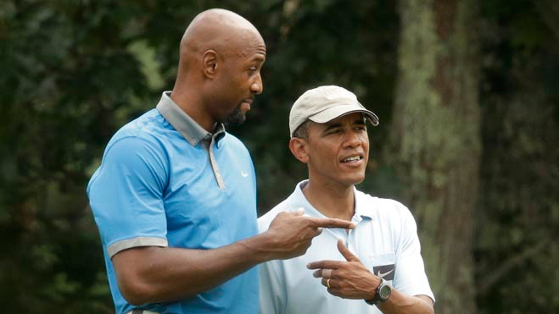 Aug. 17, 2014: Former NBA star Alonzo Mourning, left, and President Obama golfing at Farm Neck Golf Club, in Oak Bluffs, Mass., on Martha's Vineyard.