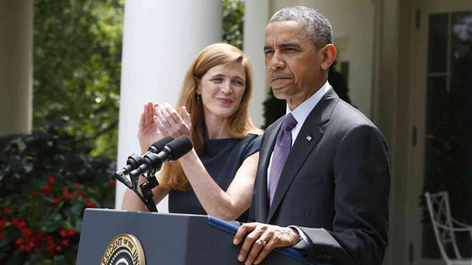 President Barack Obama stands with Samantha Power, his nominee to be the next UN Ambassador, left, Wednesday, June 5, 2013, in the Rose Garden at the White House in Washington.