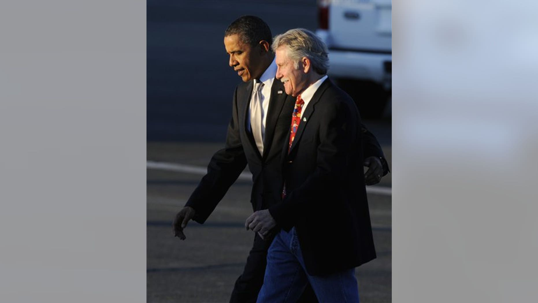 President Barack Obama walks with John Kitzhaber who is running for Oregon governor as he walks to greet supporters at Portland Air National Guard Base in Portland, Ore., Wednesday Oct 20, 2010. (AP Photo/Greg Wahl-Stephens)