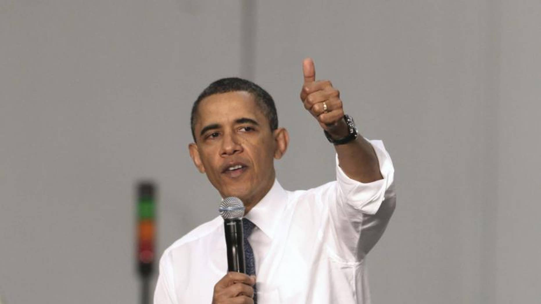 President Barack Obama gestures while addressing the crowd during a town hall meeting at ElectraTherm, Inc. a small renewable energy company in Reno, Nev., Thursday, April 21, 2011. (AP Photo/Rich Pedroncelli)