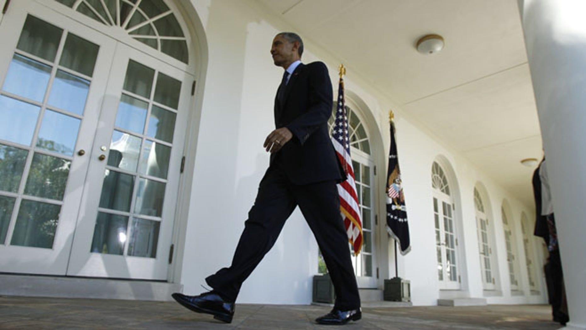 U.S. President Barack Obama departs the Rose Garden of the White House in Washington October 21, 2013.