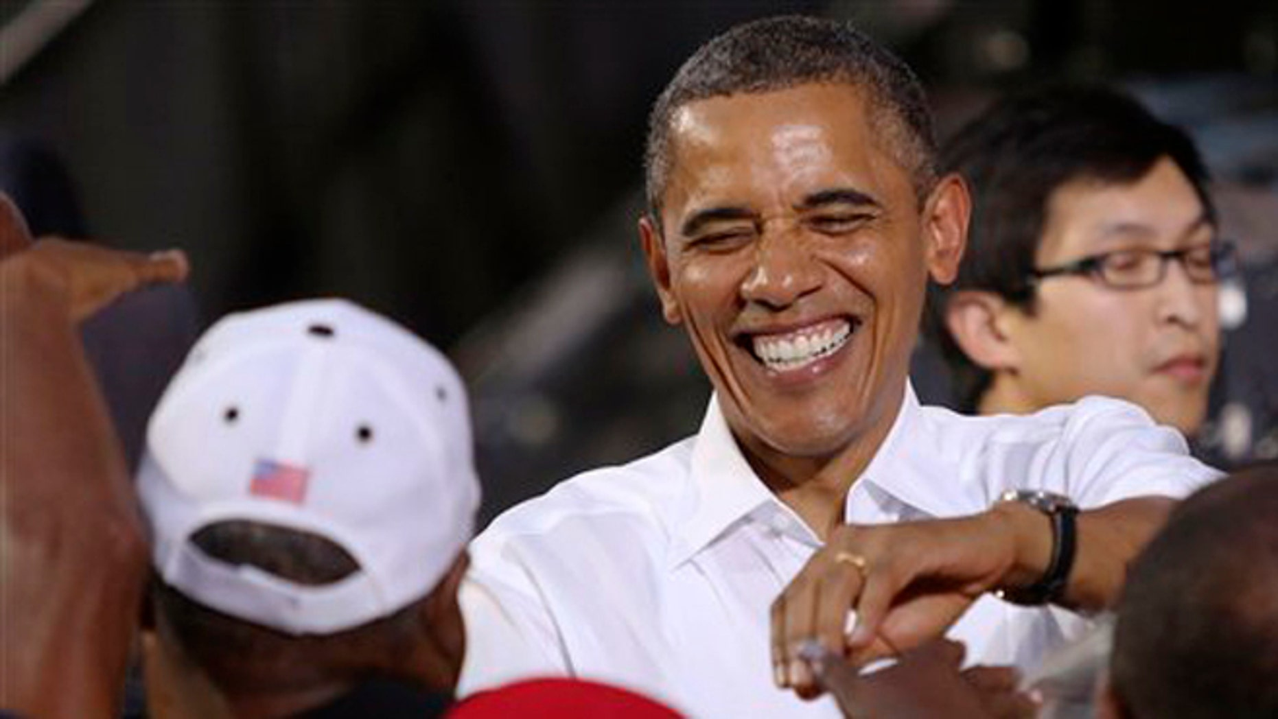 FILE: July 13, 2012: President Barack Obama greets supporters supporters following a rally in Roanoke, Va.