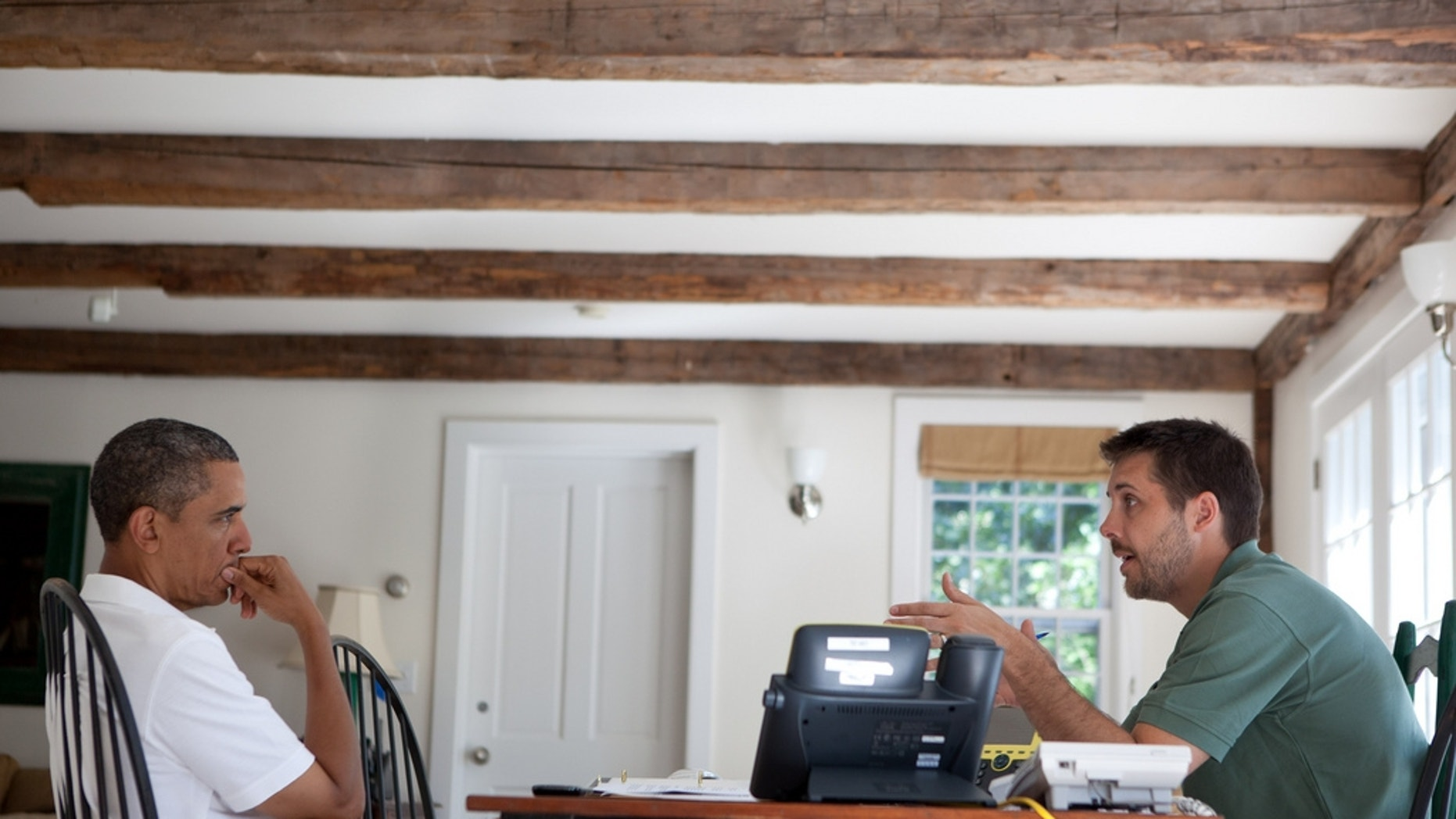 President Obama is briefed by economic adviser Brian Deese on Martha's Vineyard.  (Official White House Photo)