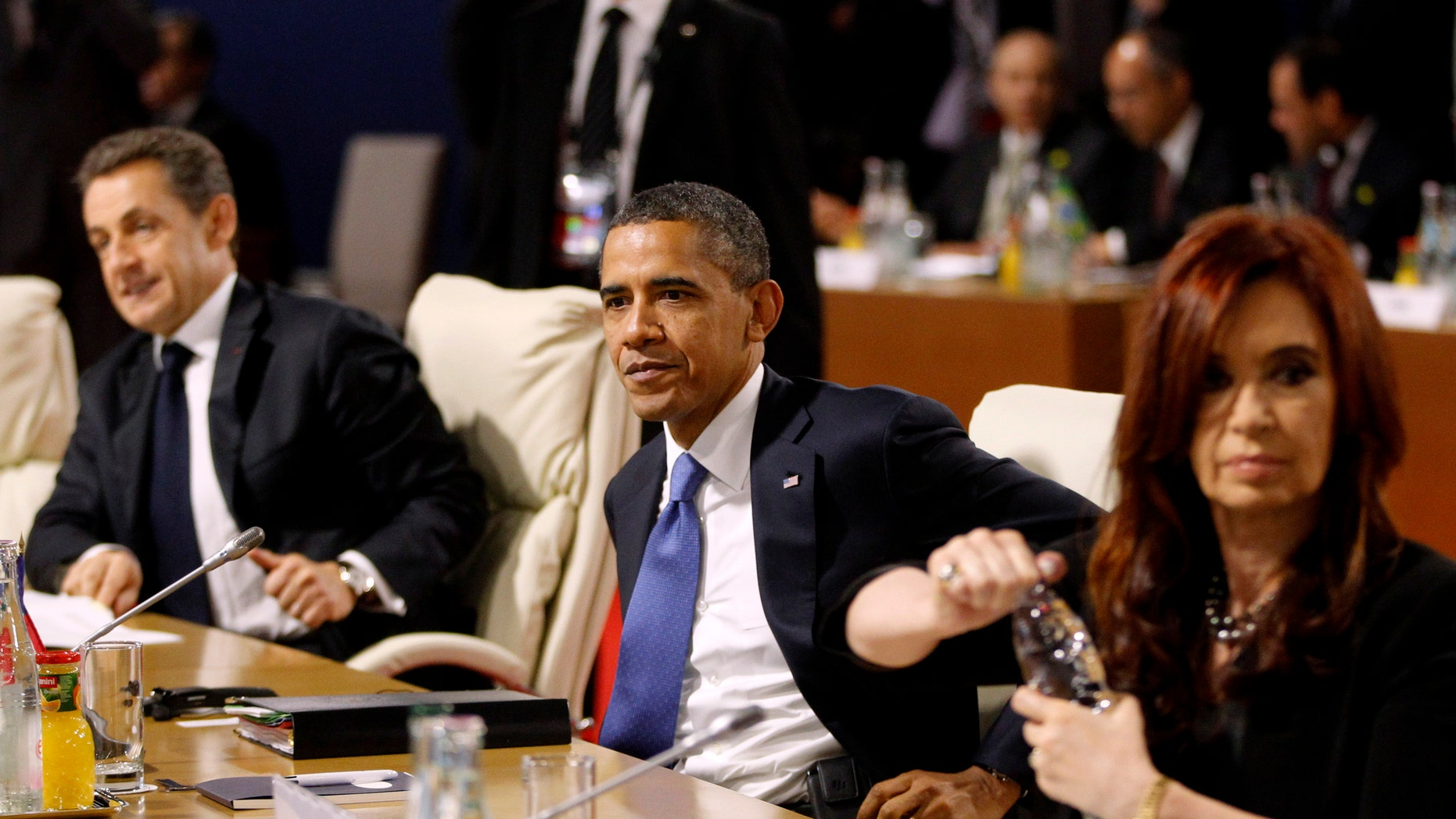 President Barack Obama, center, flanked by French President Nicolas Sarkozy, left, and Argentina President Cristina Fernandez is seen during a working lunch at the G20 Summit in Cannes, France, Thursday, Nov. 3, 2011. (AP Photo/Charles Dharapak)