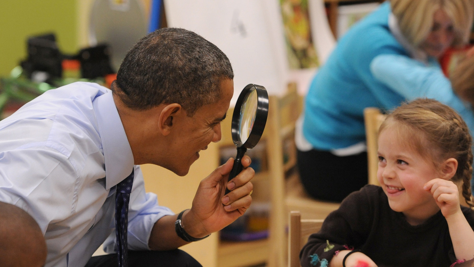 FILE: Feb. 14, 2013: President Obama plays with a young girl during a visit to College Heights Early Childhood Learning Center in Decatur, Ga.