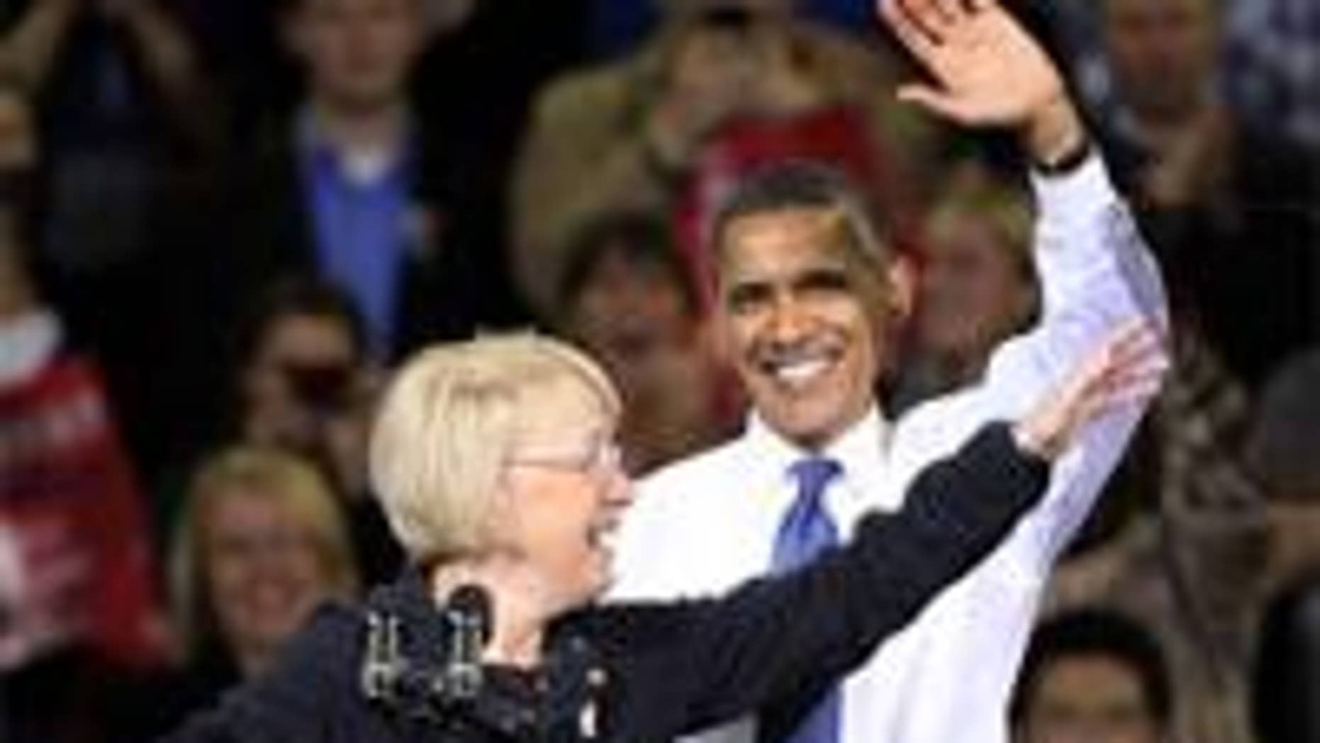 President Barack Obama and Sen. Patty Murray, D-Wash., wave during at a rally at the University of Washington in Seattle, Thursday, Oct. 21, 2010. (AP Photo)