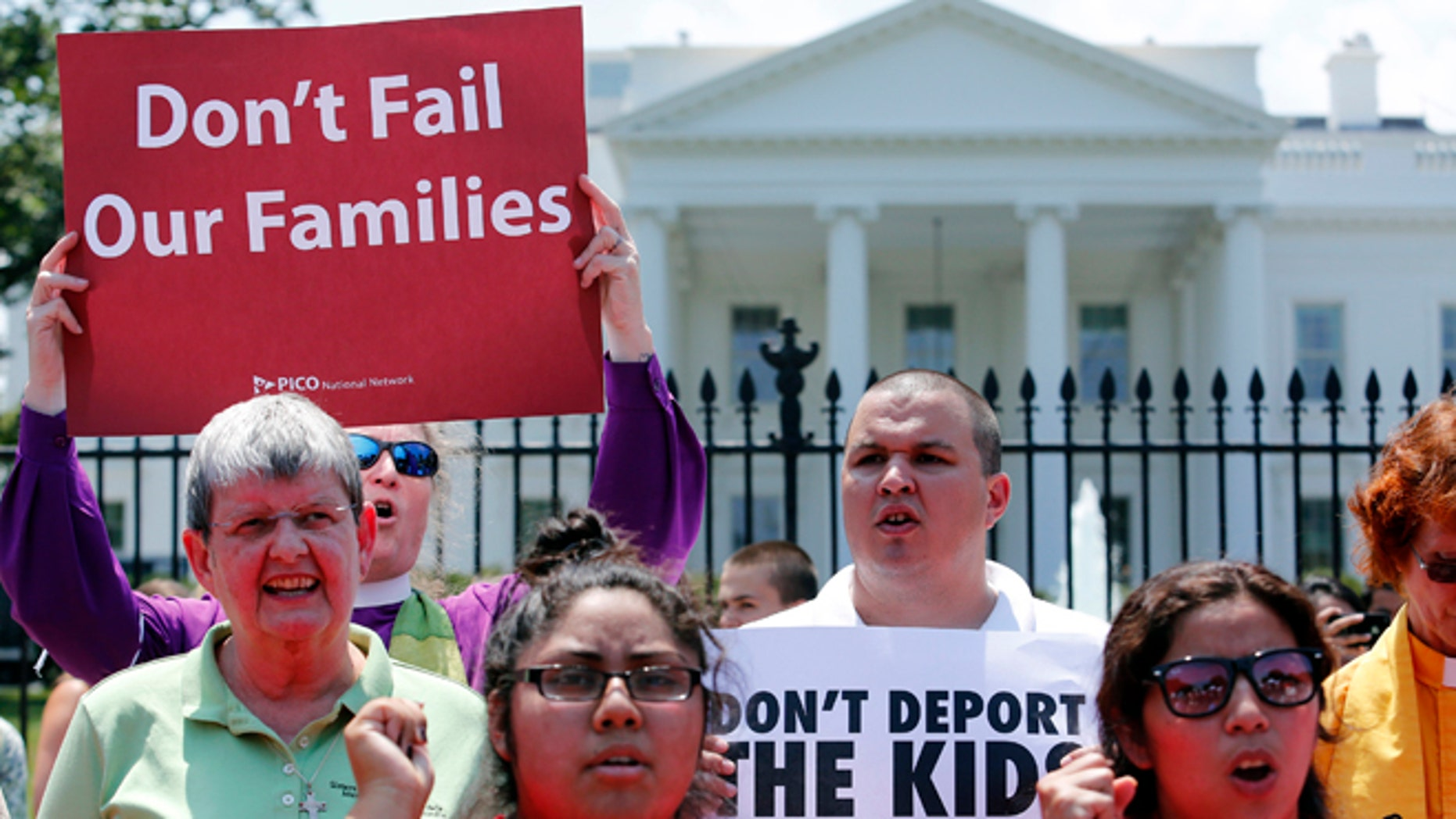 FILE: July 31, 2014: Church groups protest against President Obama's immigration policies outside the White House, Washington, D.C.
