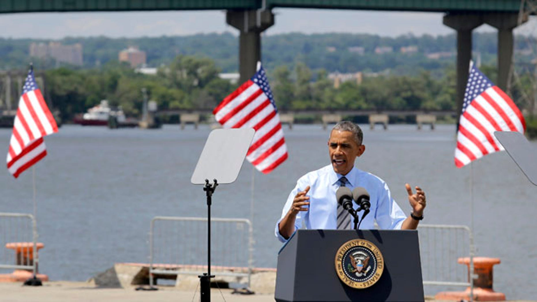 President Barack Obama speaks in front of the Interstate 495 bridge over the Christina River near Wilmington, Del., Thursday, July 17, 2014.