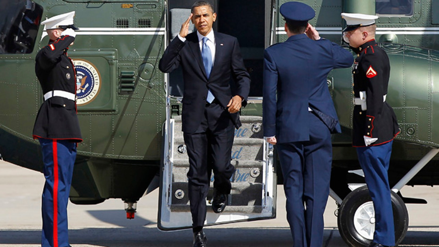March, 7, 2012: President Obama steps off the Marine One helicopter before boarding Air Force One for his departure from Andrews Air Force Base, Md.