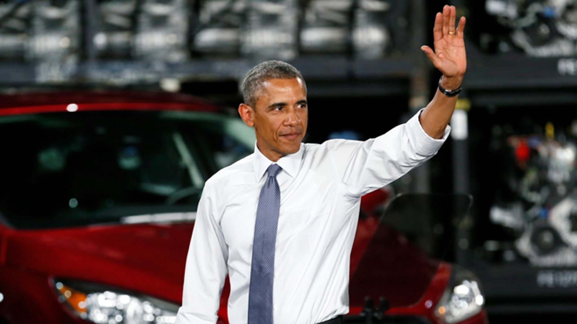 President Barack Obama waves to the audience at the Ford Michigan Assembly Plant in Wayne, Mich., Wednesday, Jan. 7, 2015.