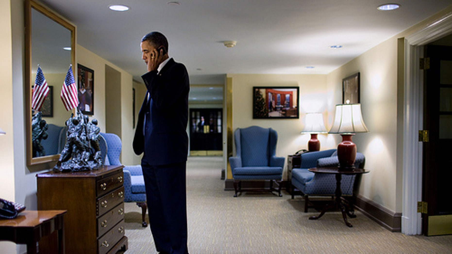 President Barack Obama talks with Arizona Gov. Jan Brewer concerning the shooting of Rep. Gabrielle Giffords and others, on a cell phone in the hallway outside the Situation Room of the White House, Saturday, Jan. 8, 2011. (Official White House Photo by Pete Souza)
