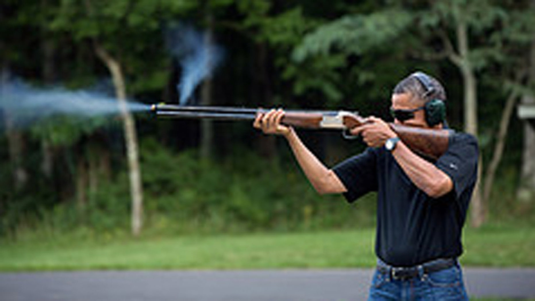 Aug. 14, 2012. In this White House photo, President Obama purportedly shoots at clay targets at Camp David, near Frederick, Md.