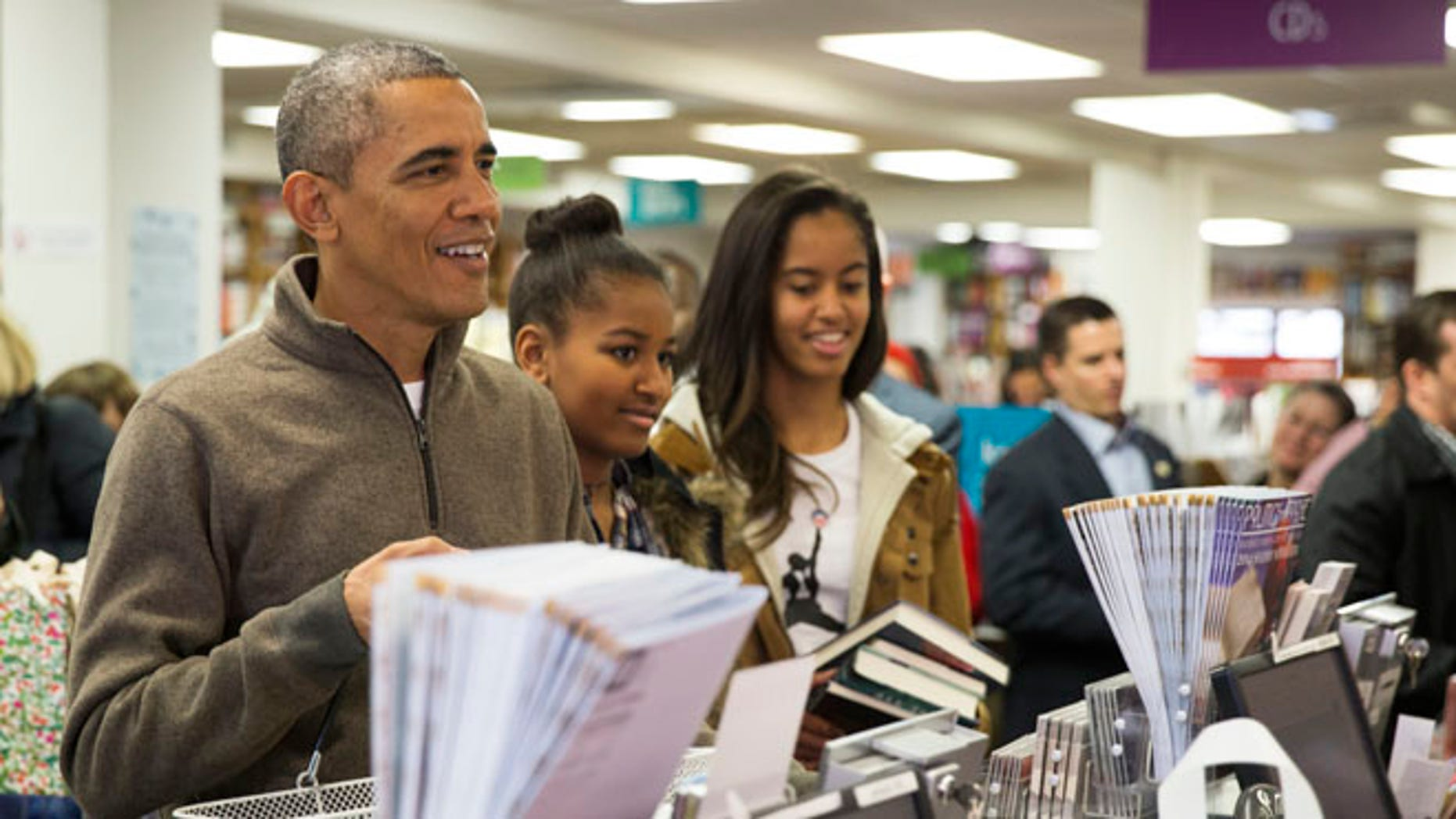 Nov. 29, 2014: President Obamashops with daughters, Sasha, center, and Malia, at Politics and Prose bookstore, in Washington, D.C.