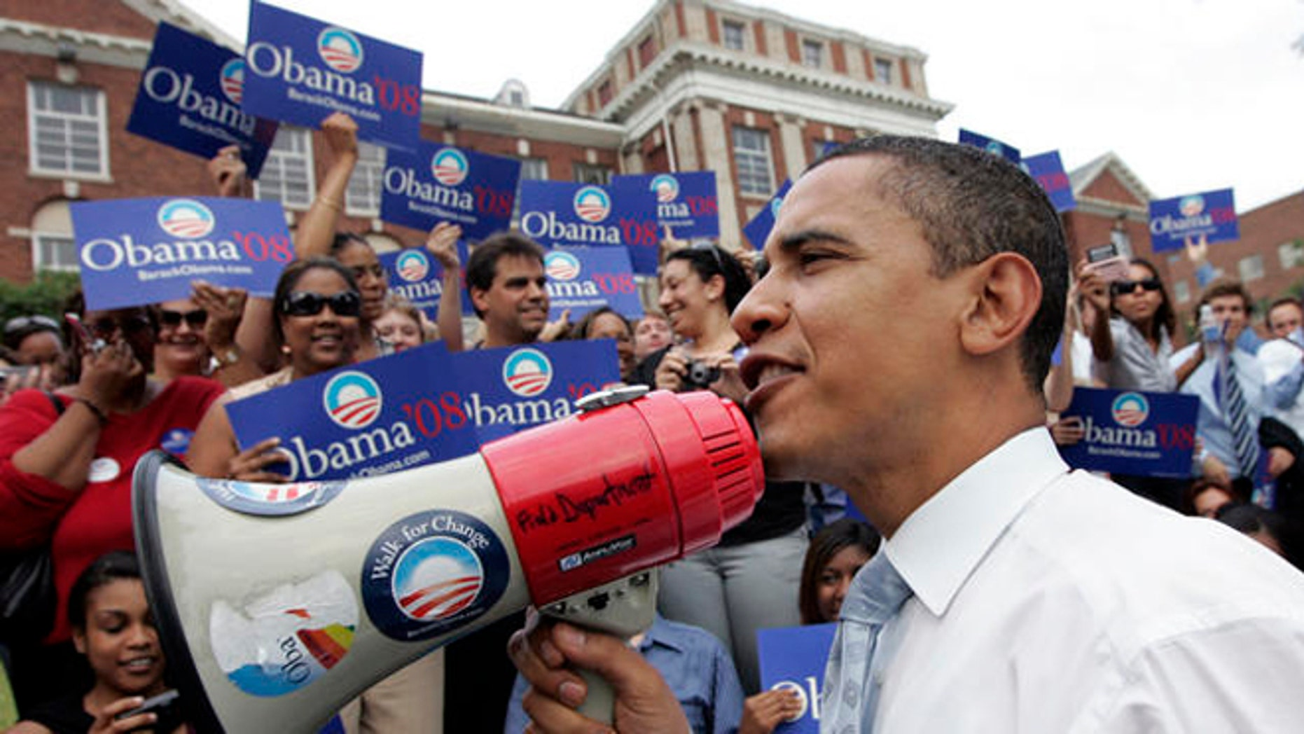 FILE:  June 2007: Then-presidential candidate Barack Obama greets a crowd of mostly young supporters at Howard University in Washington, D.C.