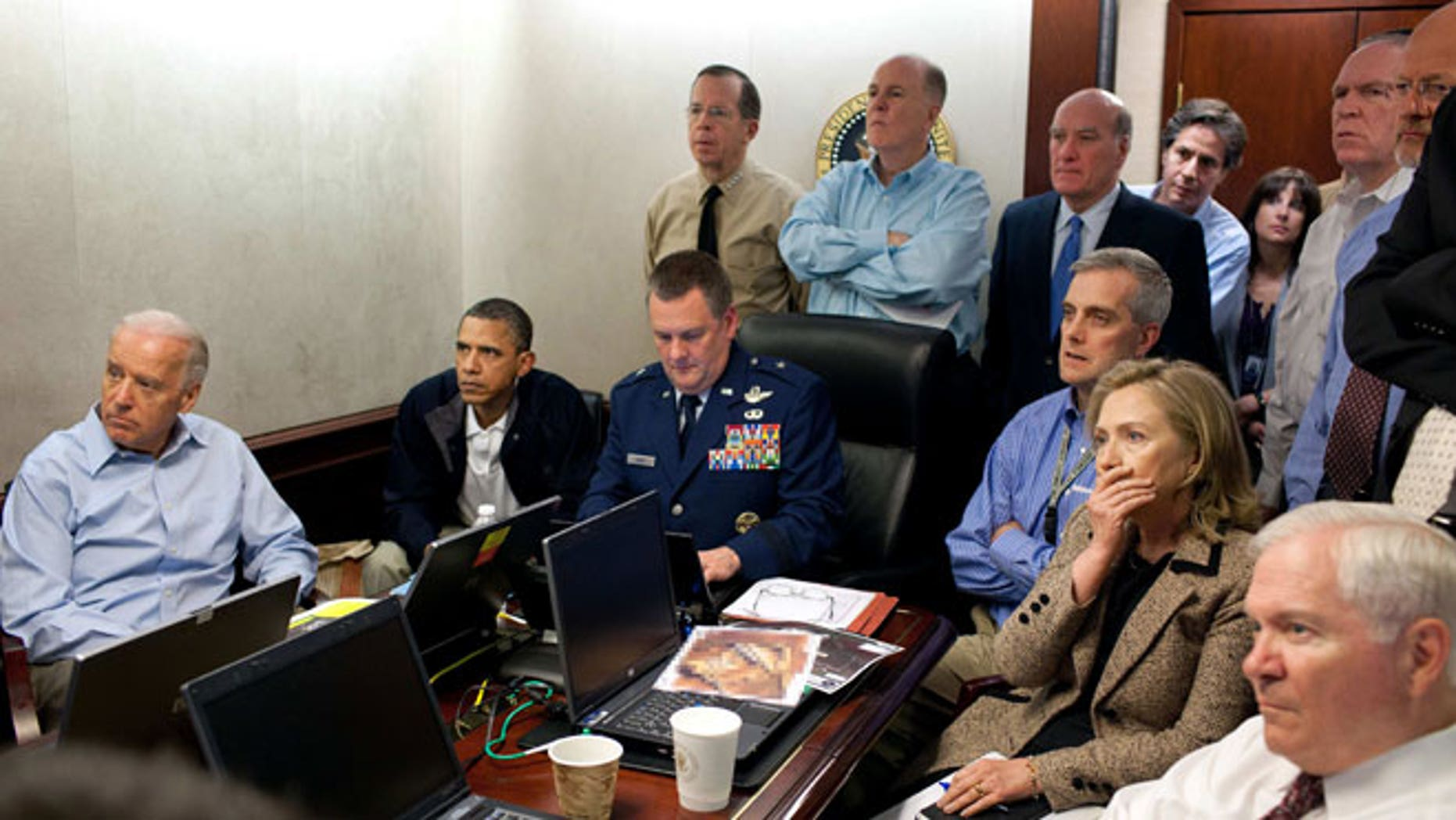 In this May 1, 2011 image released by the White House and digitally altered by the source to obscure the details of a document on the table, President Barack Obama, second from left, Vice President Joe Biden, left, Secretary of Defense Robert Gates, right, Secretary of State Hillary Rodham Clinton, second right, and members of the national security team watch an update on the mission against Usama bin Laden in the Situation Room of the White House in Washington.