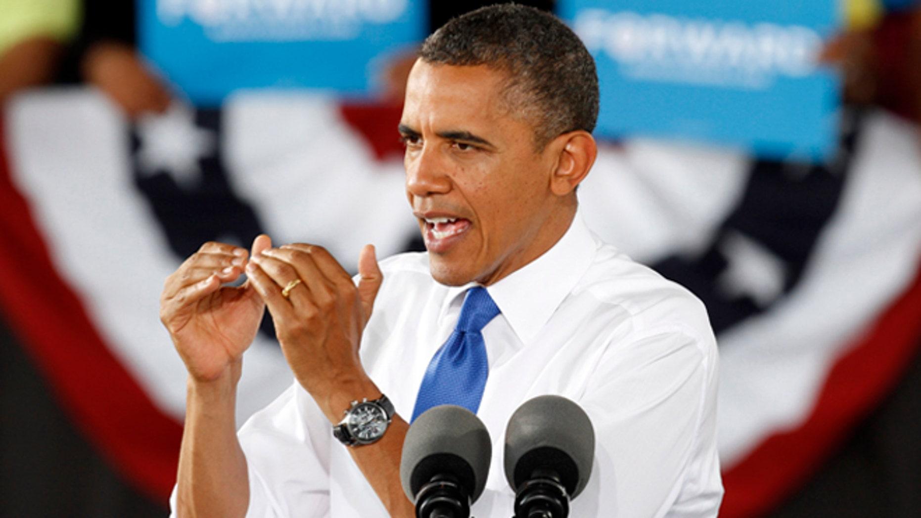 El presidente Barack Obama habla en un mitin en Virginia Beach, Virginia, el jueves 27 de septiembre de 2012. (Foto AP/Steve Helber)