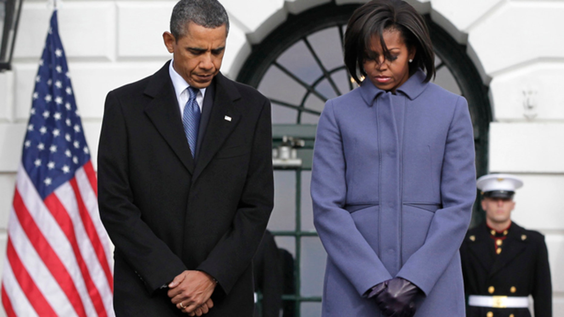 Monday: President Obama and first lady Michelle Obama are joined by government employees on the South Lawn of the White House in Washington, to observe a moment of silence for Rep. Gabrielle Giffords, D-Ariz., and the other victims of an assassination attempt against her. The shooting at a town hall-style event outside a supermarket in Tucson, Ariz., Saturday left six dead, including a federal judge, and critically wounded Rep. Gabrielle Giffords.