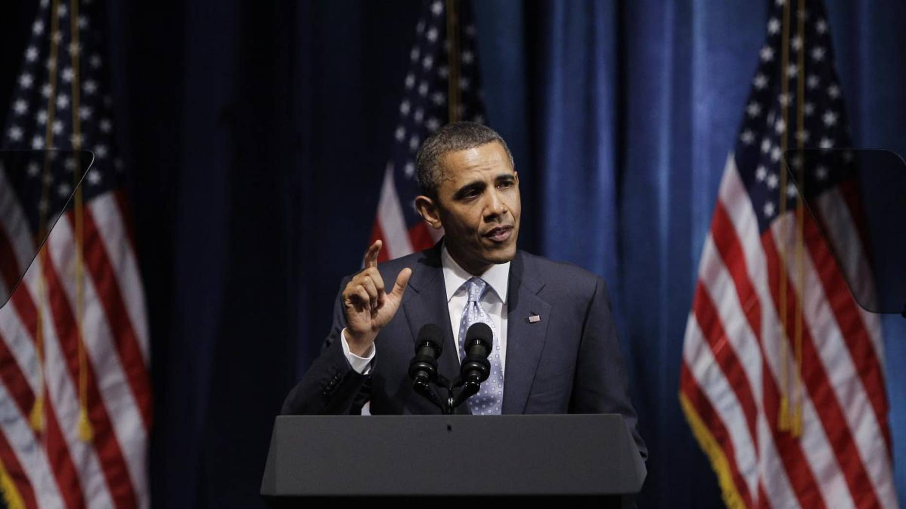 AP image/President Obama at a DNC fundraiser in Texas
