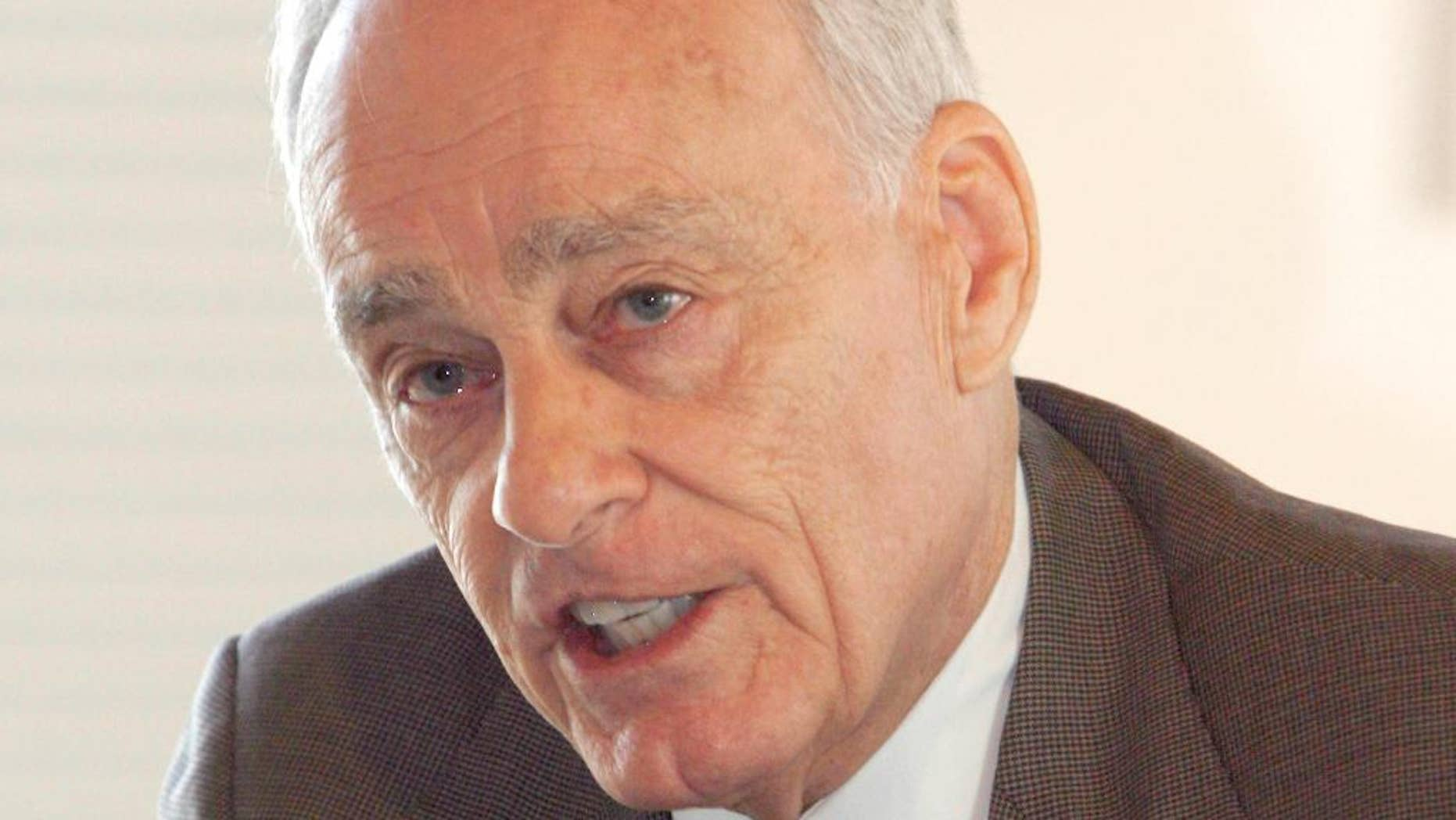 """File-This Sept. 18, 2008, file photo shows Vincent Bugliosi speaking at a news conference in Burlington, Vt. The prosecutor in the Charles Manson trial who went on to write the best-selling true-crime book, """"Helter Skelter,"""" has died. Bugliosi was 80 years old. His son Vincent Bugliosi Jr. tells the Associated Press Monday, June 8, 2015, that Bugliosi died of cancer Saturday at a hospital in Los Angeles. (AP Photo/Toby Talbot, File)"""