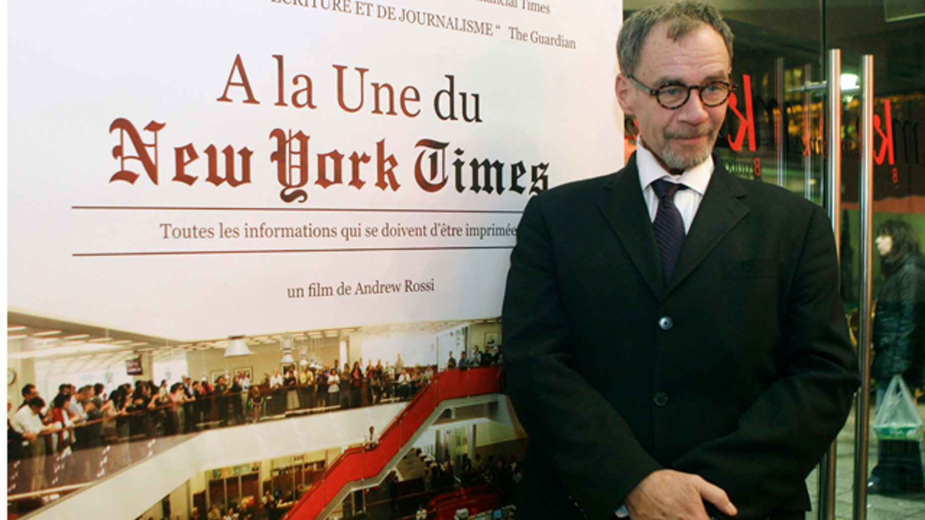 FILE - In this Nov. 21, 2011, file photo, New York Times journalist David Carr poses for a photograph as he arrives for the French premiere of the documentary 'Page One: A Year Inside The New York Times' in Paris. Carr collapsed at the office and died in a hospital Thursday, Feb. 12, 2015. He was 58. Carr wrote the Media Equation column for the Times, focusing on issues of media in relation to business and culture. (AP Photo/Michel Euler, File)