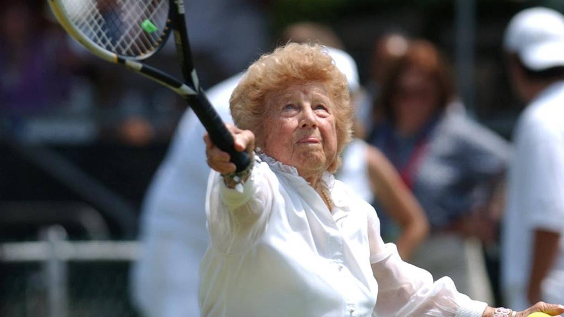 """FILE - In this July 10, 2004, file photo, Tennis great Dorothy """"Dodo"""" Cheney, 87, of Santa Monica, Calif., plays during an exhibition match prior to ceremonies celebrating the 50th anniversary of the Tennis Hall of Fame in Newport, R.I. The International Tennis Hall of Fame says Cheney, a member of the Hall and the first American woman to win the tournament now known as the Australian Open, has died at age 98. The Hall says Tuesday, Nov. 25, 2014, that Cheney died Sunday in Escondido, Calif., following a brief illness. (AP Photo/Victoria Arocho, File)"""