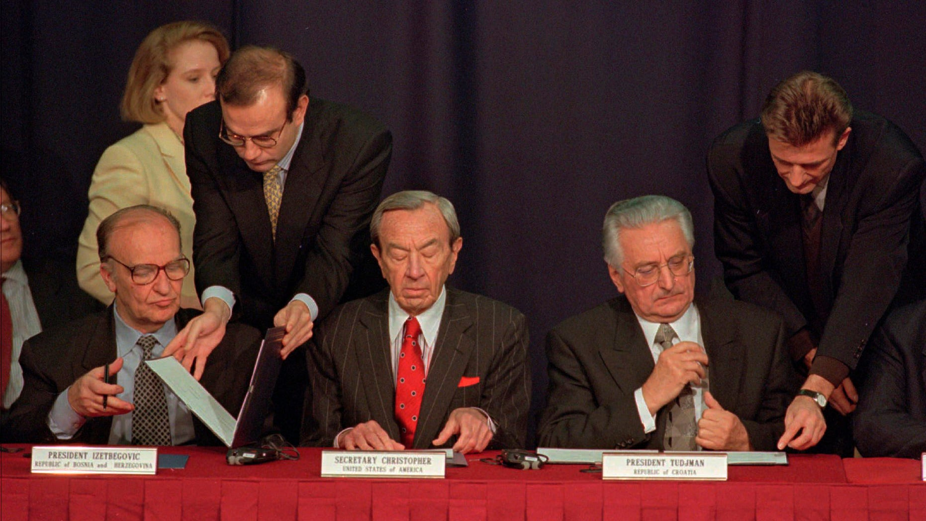 Then Secretary of State Warren Christopher, center, is flanked by Bosnia President Alija Izetbegovic, left, and Croatian President Franjo Tudjman as they sign the Dayton peace accord in this Nov. 10, 1995 file photo taken at Wright-Patterson Air Force Bae in Dayton, Ohio. (AP)