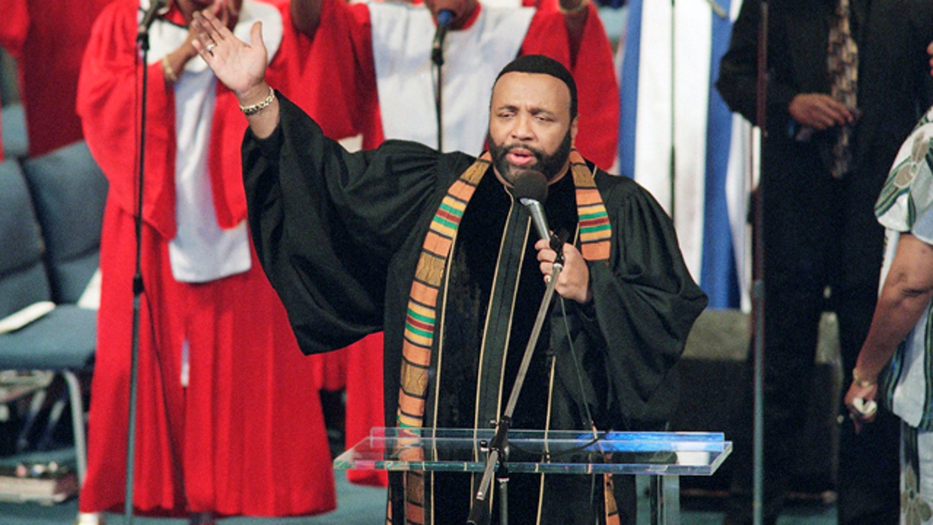 FILE - In this Sept. 1, 1996 file photo, Grammy winning gospel singer Andrae Crouch sings during service at the Christ Memorial church in Pacoima, Calif. Crouch, a legendary gospel performer, songwriter and choir director whose work graced songs by Michael Jackson and Madonna and movies such as The Lion King, has died at age 72. (AP Photo/Frank Wiese, File)