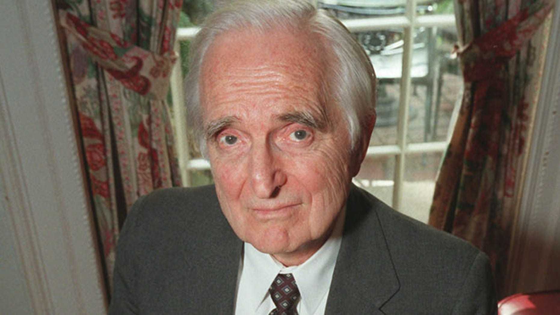 April 9, 1997: In this file photo, Doug Engelbart, inventor of the computer mouse and winner of the half-million dollar 1997 Lemelson-MIT prize, poses with the computer mouse he designed, in New York.