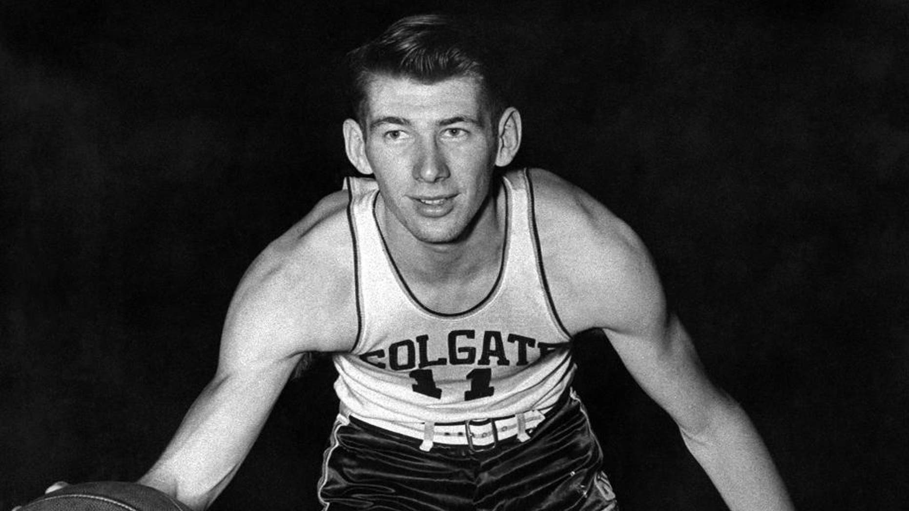FILE - In this April 1, 1947, file photo provided by Madison Square Garden, Colgate basketball player Ernie Vandeweghe poses in uniform. Vandeweghe, the former Colgate and New York Knicks player and father of former NBA star Kiki Vandeweghe and pro tennis player CoCo Vandeweghe, has died. He was 86. The death was confirmed Sunday, Nov. 9, 2014, by the NBA through its NBA history Twitter feed and by granddaughter CoCo Vandeweghe in a Facebook post. (AP Photo/Madison Square Garden, File)