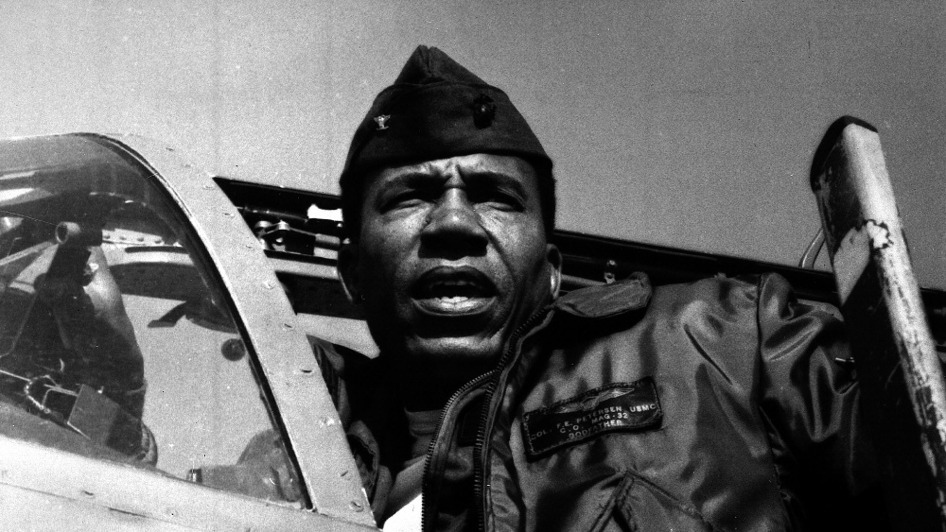 This undated photo provided by the Marine Corps shows Lt. Gen. Frank E. Petersen, Jr., the first black aviator and brigadier general in Marine Corps. Frank E. Petersen III said his father died Tuesday, Aug. 25, 2015, at his home in Stevensville, on Maryland's Kent Island, of complications from lung cancer. He was 83. (Marine Corps via AP)