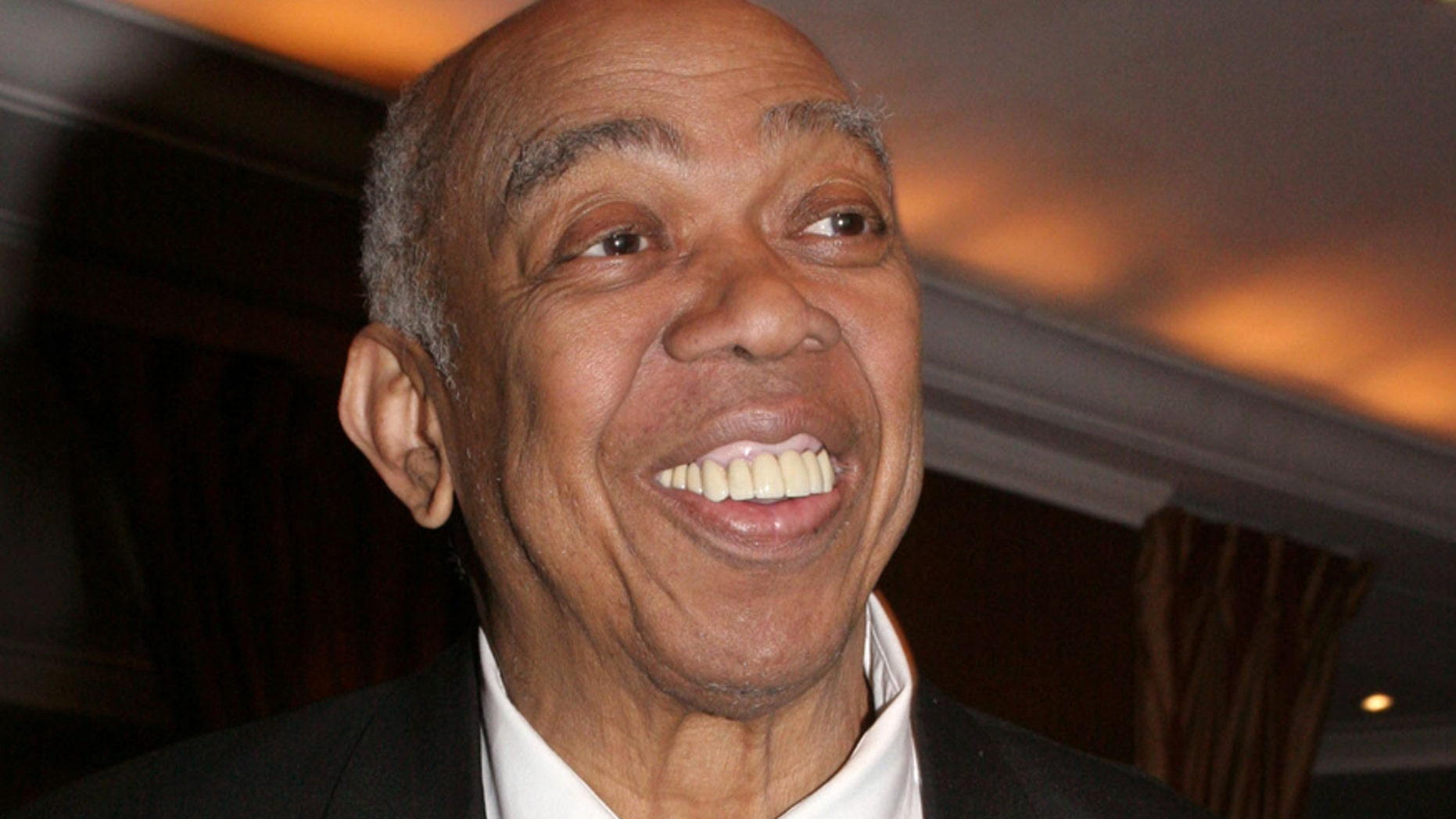 """In this March 10, 2005 file photo, Geoffrey Holder poses at the French Institute Alliance Francaise' """"La Nuit des Etoiles"""" dinner  in New York, honoring French actress Catherine Deneuve."""