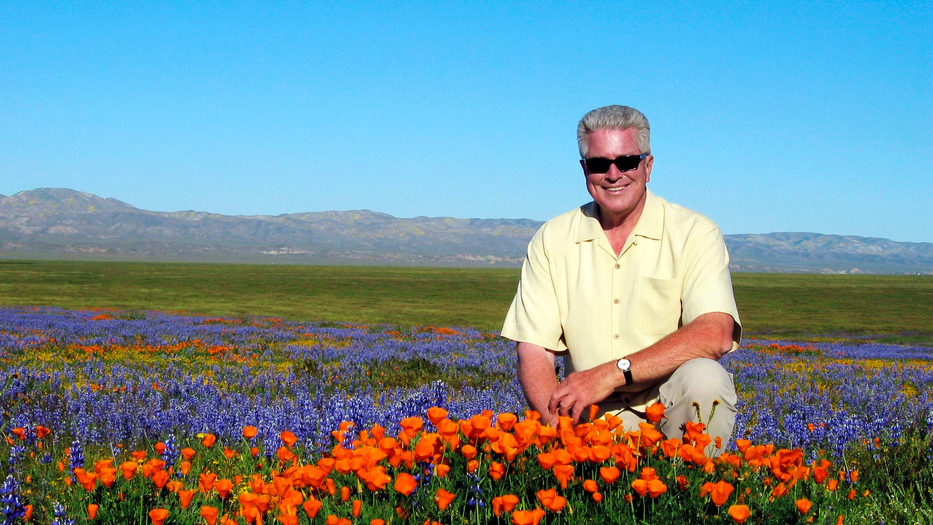 2005 FILE: TV host Huell Howser poses for a photo at the Antelope Valley California Poppy Reserve in Lancster, Calif.