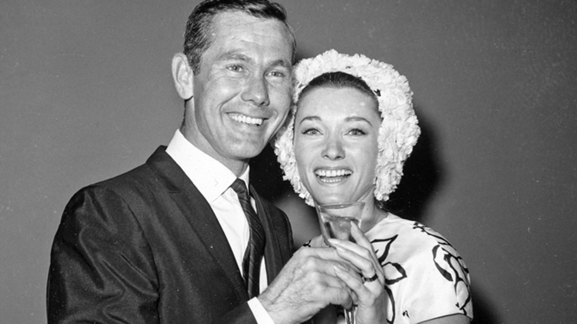 This Aug. 17, 1963 file photo shows comedian Johnny Carson and his bride, former television personality and model Joanne Copeland, at a reception in his apartment after their wedding at in New York.