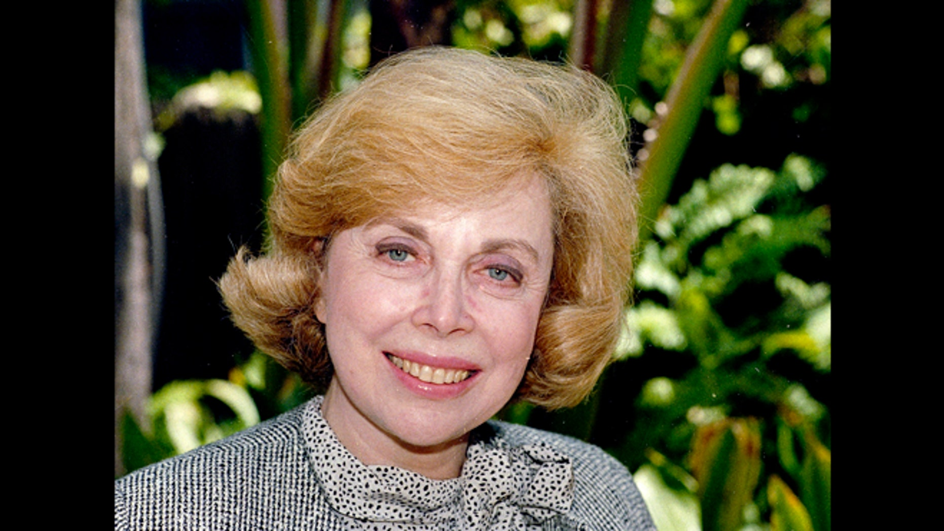 """In this Sept. 1, 1987 file photo, Dr. Joyce Brothers takes a break from a busy schedule in Los Angeles to talk about her upcoming television series, """"The Psychology Behind the News."""" Brothers died Monday, May 13, 2013, in New York City, according to publicist Sanford Brokaw. She was 85."""