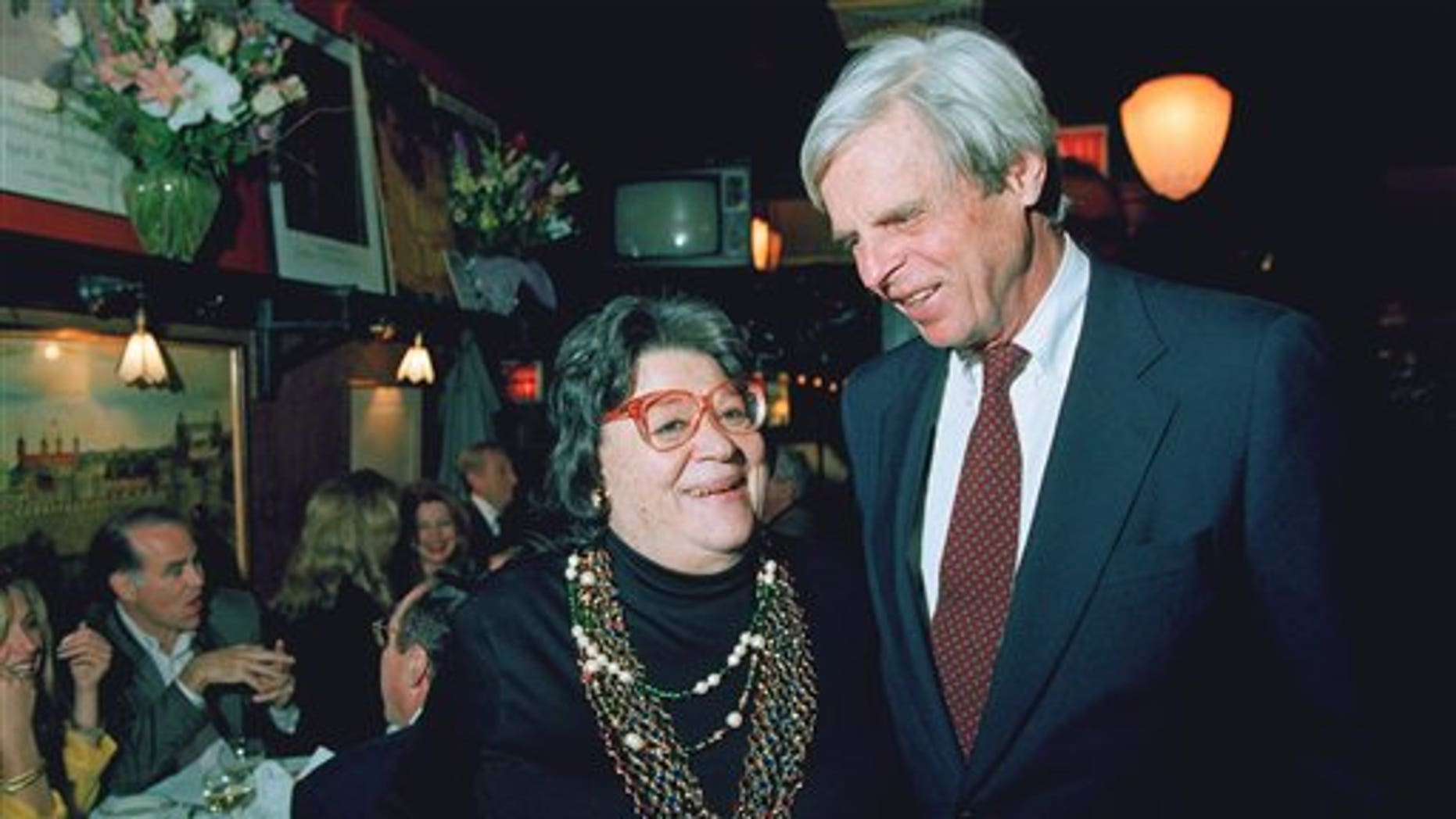 """In this April 27, 1993 file photo, restaurateur Elaine Kaufman, left, stands with author George Plimpton at her restaurant """"Elaines"""" in New York. (AP)"""