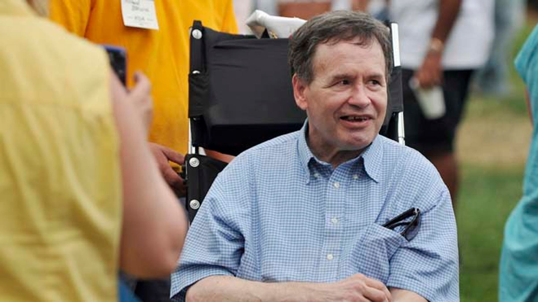 This Aug. 12, 2012 photo shows former Illinois Congressman Lane Evans in Davenport, Iowa, during a visit by President Barack Obama.