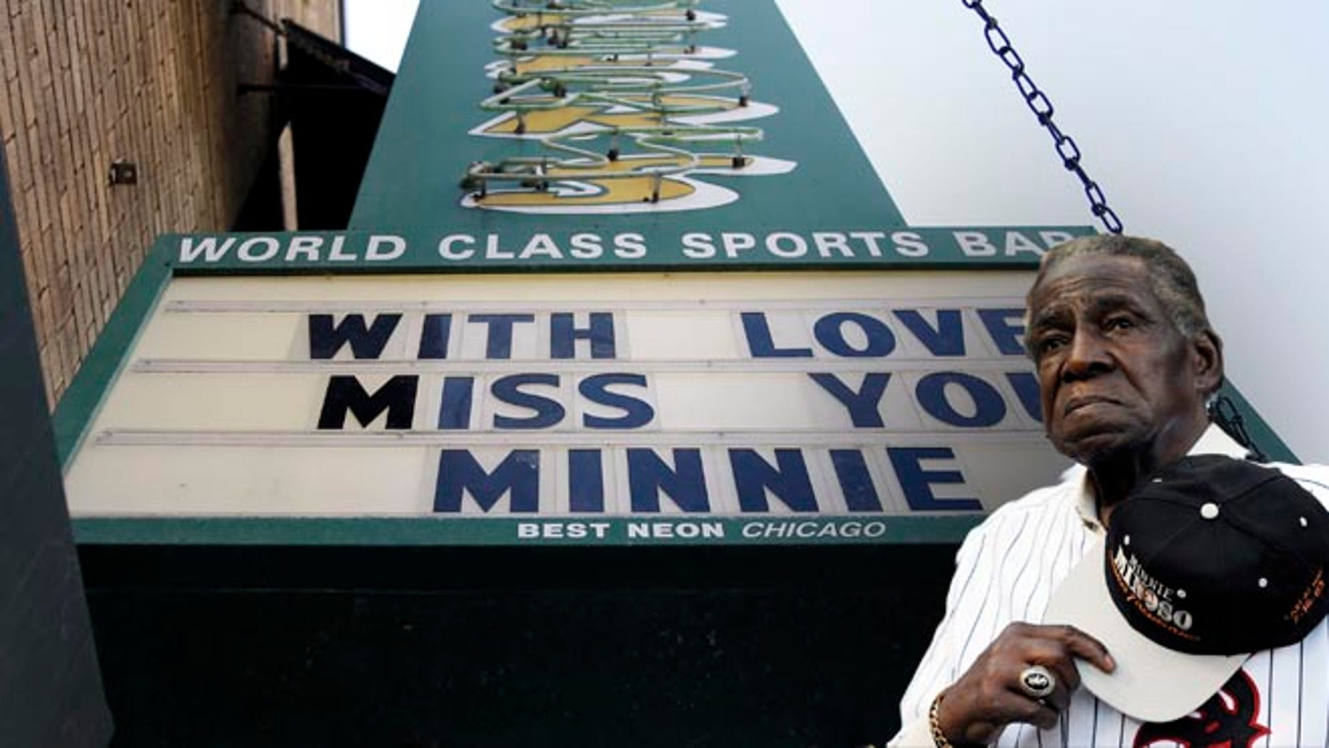 A sign displays at  Sluggers sports bar in honor of  Minnie Minoso on Sunday, March 1, 2015, in Chicago. Chicago White Sox legend Minnie Minoso passed away at age of 90. Minoso was the first black Cuban player in Major League Baseball and the first black player for the White Sox. (AP Photo/Nam Y. Huh)