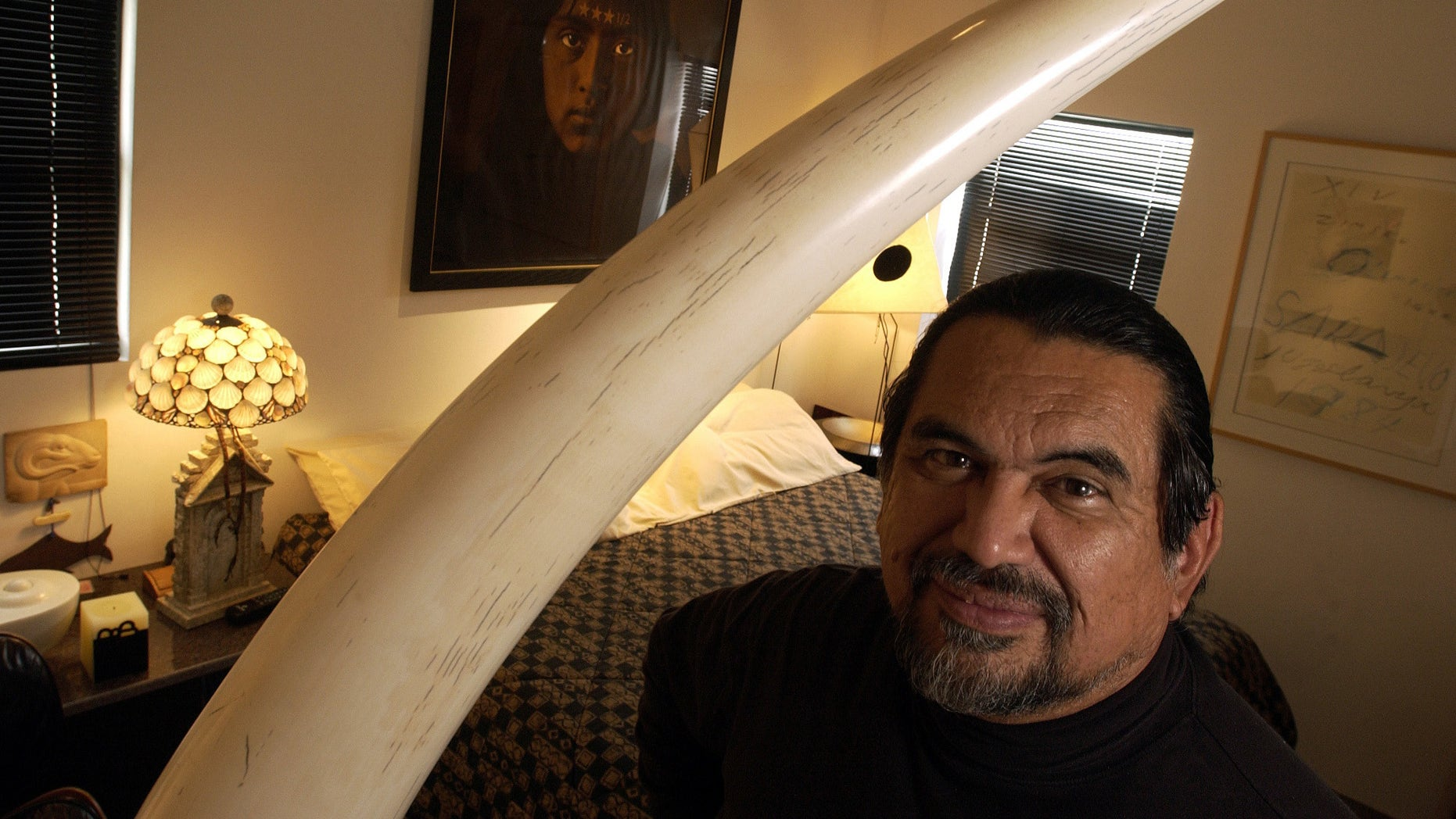 Sculptor Jesus Moroles in his home in Rockport, Texas, in a Feb. 2004 file photo.