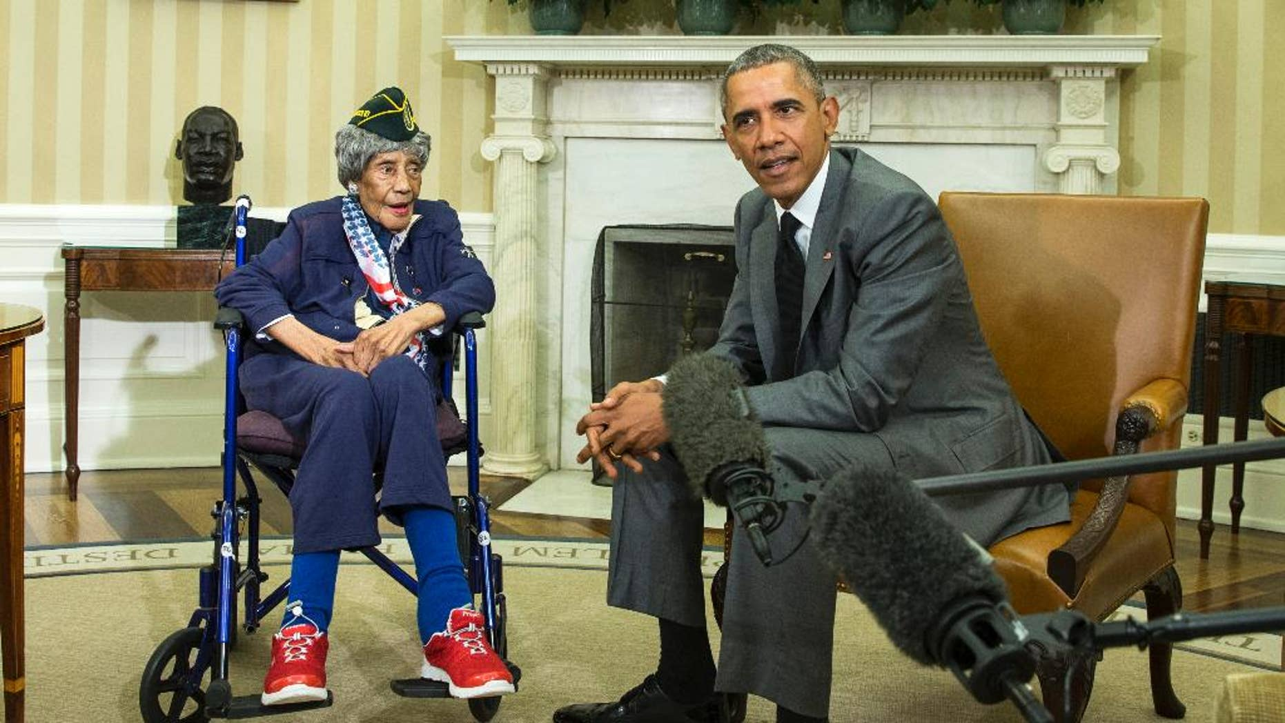 FILE - In this July 17, 2015, file photo, President Barack Obama meets with Emma Didlake, 110, of Detroit, the oldest known World War II veteran, in the Oval Office of the White House in Washington. The Michigan woman who was believed to be the nation's oldest veteran has died a month after meeting the president. The Oakland County medical examiner's office says Didlake died Sunday, Aug. 16 in West Bloomfield, northwest of Detroit. (AP Photo/Evan Vucci, File)