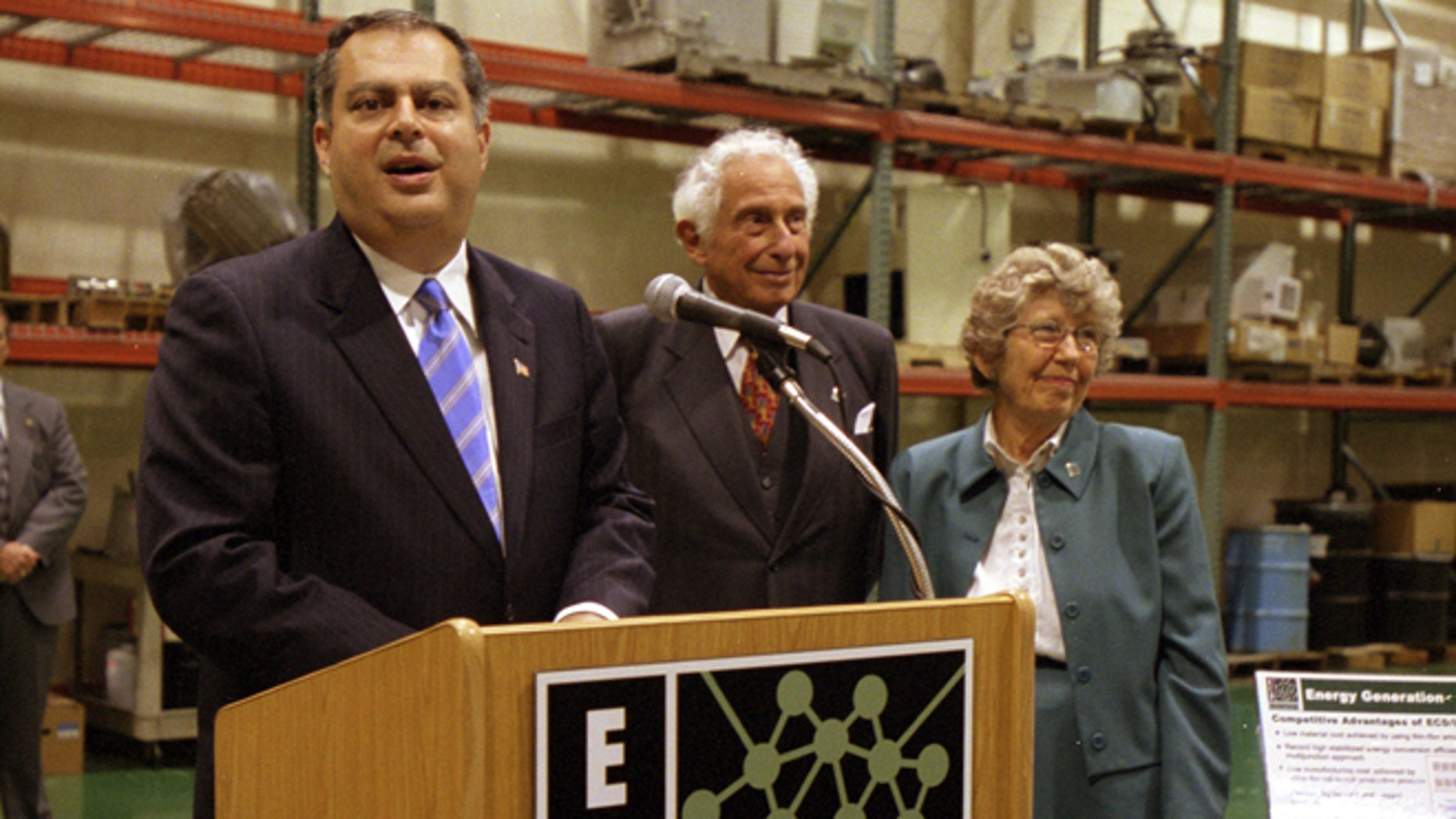 FILE -  This Aug. 23, 2002 file photo shows Stanford Ovshinsky, center, co-founder of  Energy Conversion Devices Inc. with his wife Iris, right, appeared with U.S. Secretary of Energy Spencer Abraham at a news conference at the companys offices in Rochester Hills, Mich., on Aug. 23, 2002. Stan Ovshinsky, 89, died Wednesday, Oct. 17, 2012, at his home in Bloomfield Hills from complications of prostate cancer. (AP Photo/Kathleen Wayt, file)