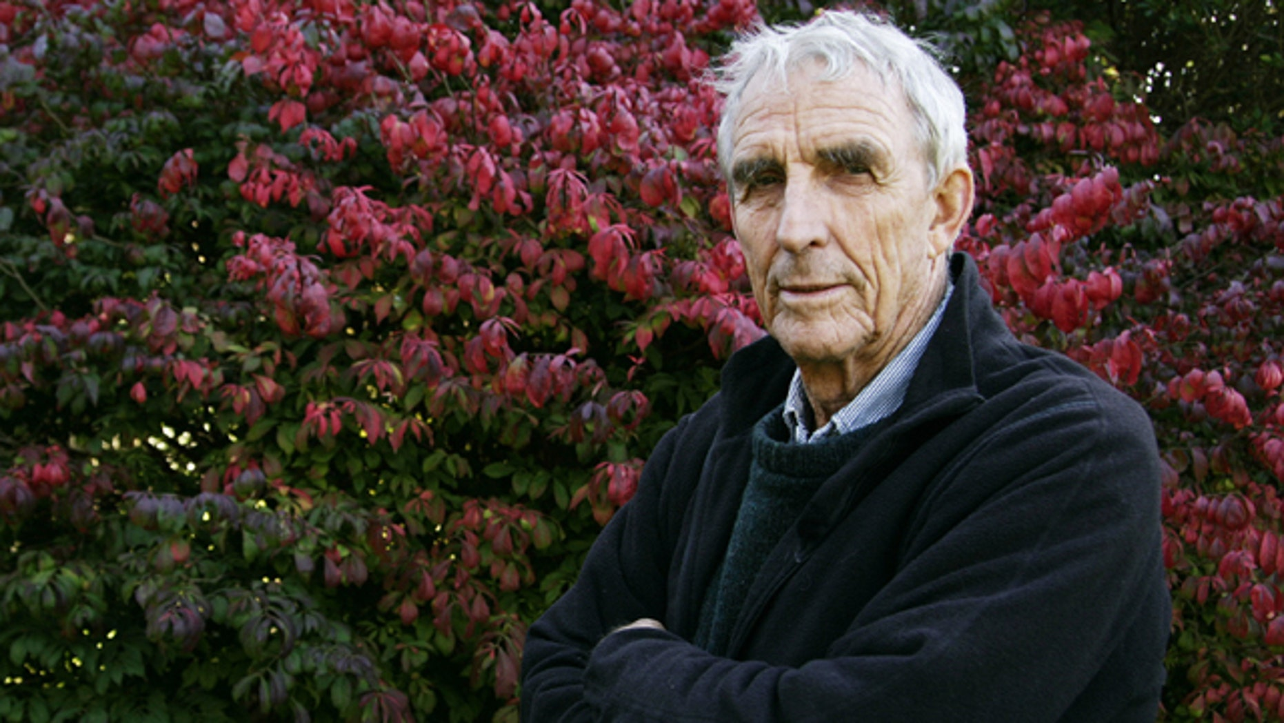 FILE - Writer Peter Matthiessen stands in the yard of his house in Sagaponack, N.Y. in this Oct. 28, 2004 file photo. Matthiessen, award-winning author of more than thirty books, world-renowned naturalist, explorer, Buddhist teacher, and political activist, died Saturday, April 5, 2014 after an illness of some months,according to his publisher Geoff Kloske of Riverhead Books. He was 86.  (AP Photo/Ed Betz, File)