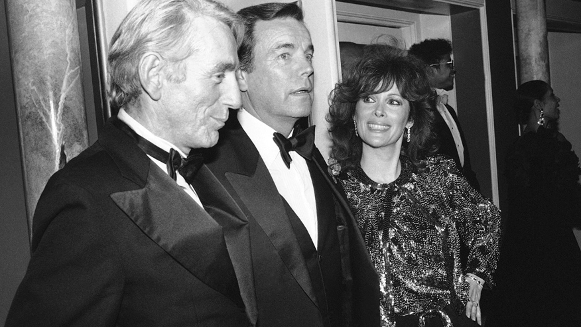 """FILE - In this Feb. 18, 1985 file photo, Jill St. John, right, with Robert Wagner, center, and Rod McKuen, left, attend a party for """"Night of 100 Stars II,"""" in New York. McKuen, the husky-voiced """"King of Kitsch"""" whose music and verse recordings won him an Oscar nomination and made him one of the best-selling poets in history, has died on Thursday, Jan. 29, 2015. He was 81."""