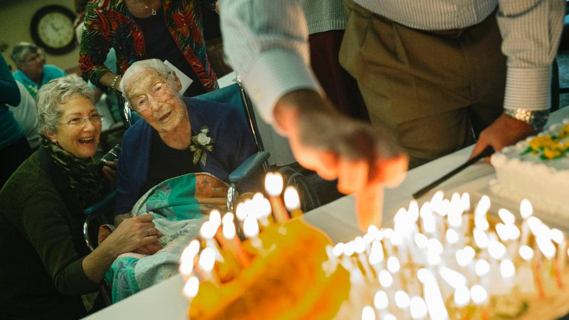 This Oct. 12, 2014 photo shows Anna Stoehr, center, celebrating her 114th birthday at Green Prairie Place senior apartments in Plainview, Minn. Stoehr, one of Minnesota's oldest residents, died Sunday, Dec. 20, 2014 in her sleep after several days in hospice care, according to her son, Harlan Stoehr. (AP Photo/The Star Tribune, Richard Tsong-Taatarii) ST. PAUL PIONEER PRESS OUT, MINNEAPOLIS-AREA TV OUT, MAGS OUT