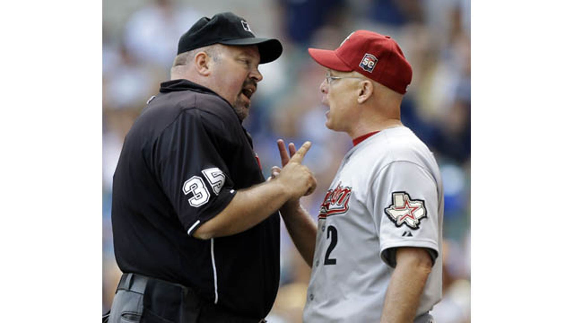 File-This Aug. 1, 2012 file photo shows Houston Astros manager Brad Mills, right, arguing with home plate umpire Wally Bell during the eighth inning of a baseball game against the Milwaukee Brewers in Milwaukee. (AP Photo)
