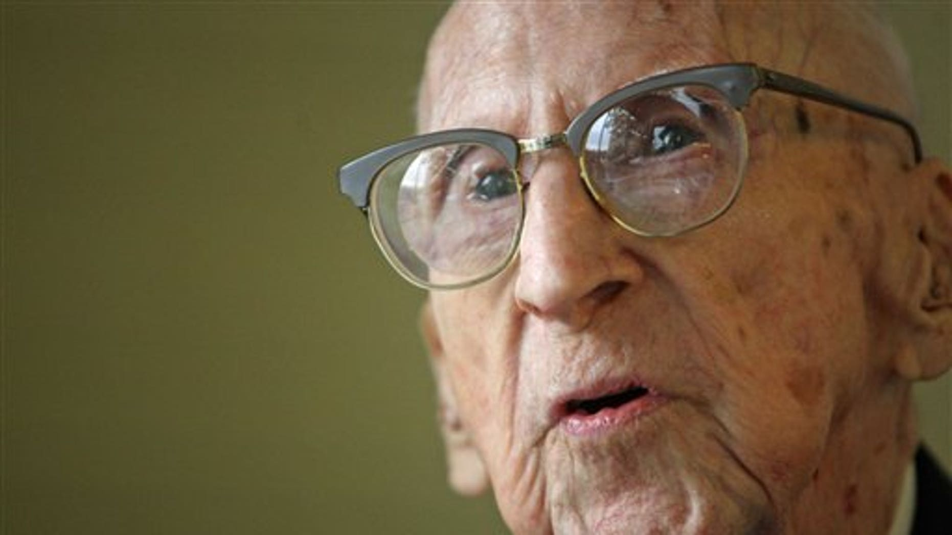114-year-old Walter Breuning sits for an interview with a reporter for the Associated Press in the lobby of his senior residence in Great Falls, Mont, on  Oct. 6, 2010. Officials at a Montana retirement home say the world's oldest man has died. Walter Breuning was 114, making him the oldest man and the second-oldest person in the world. (AP)