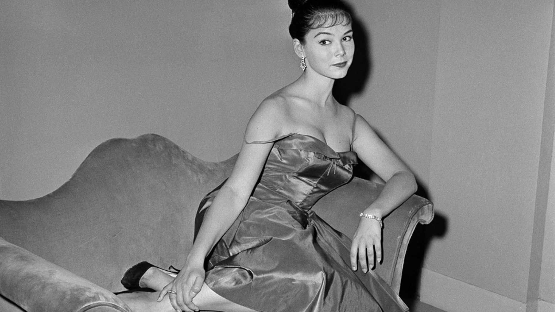 """In this July 11, 1959, file photo, actress Yvonne Craig poses on the set of """"The Gene Krupa Story,"""" in Los Angeles."""