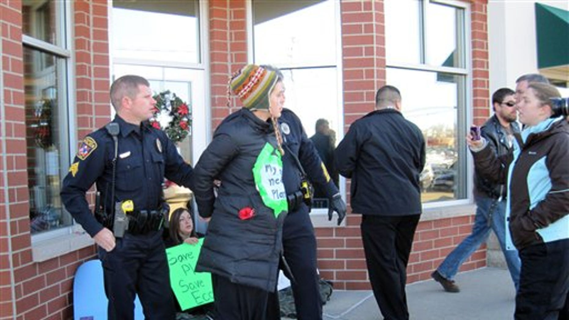 Dec. 29: Megan Felt, 24, is arrested while protesting Ron Paul's stance on the Environmental Protection Agency outside his Ankeny, Iowa, campaign office.