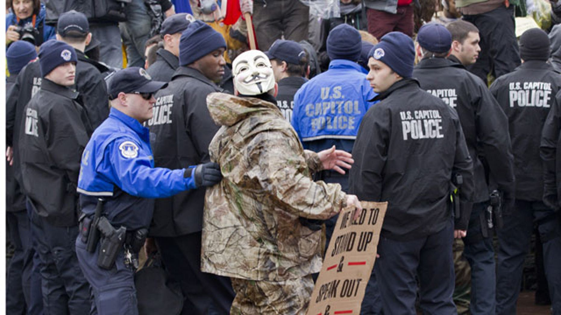 January 17, 2012: As Congress returns from its winter recess, protesters aligned with the Occupy Wall Street movement demonstrate on Capitol Hill in Washington to decry the influence of corporate money in politics.