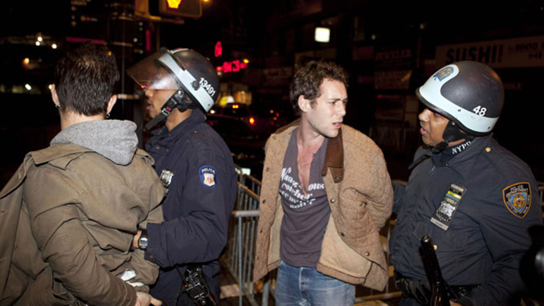 Nov. 15, 2011: Occupy Wall Street protesters are detained by police officers after being ordered to leave Zuccotti Park, their longtime encampment in New York.